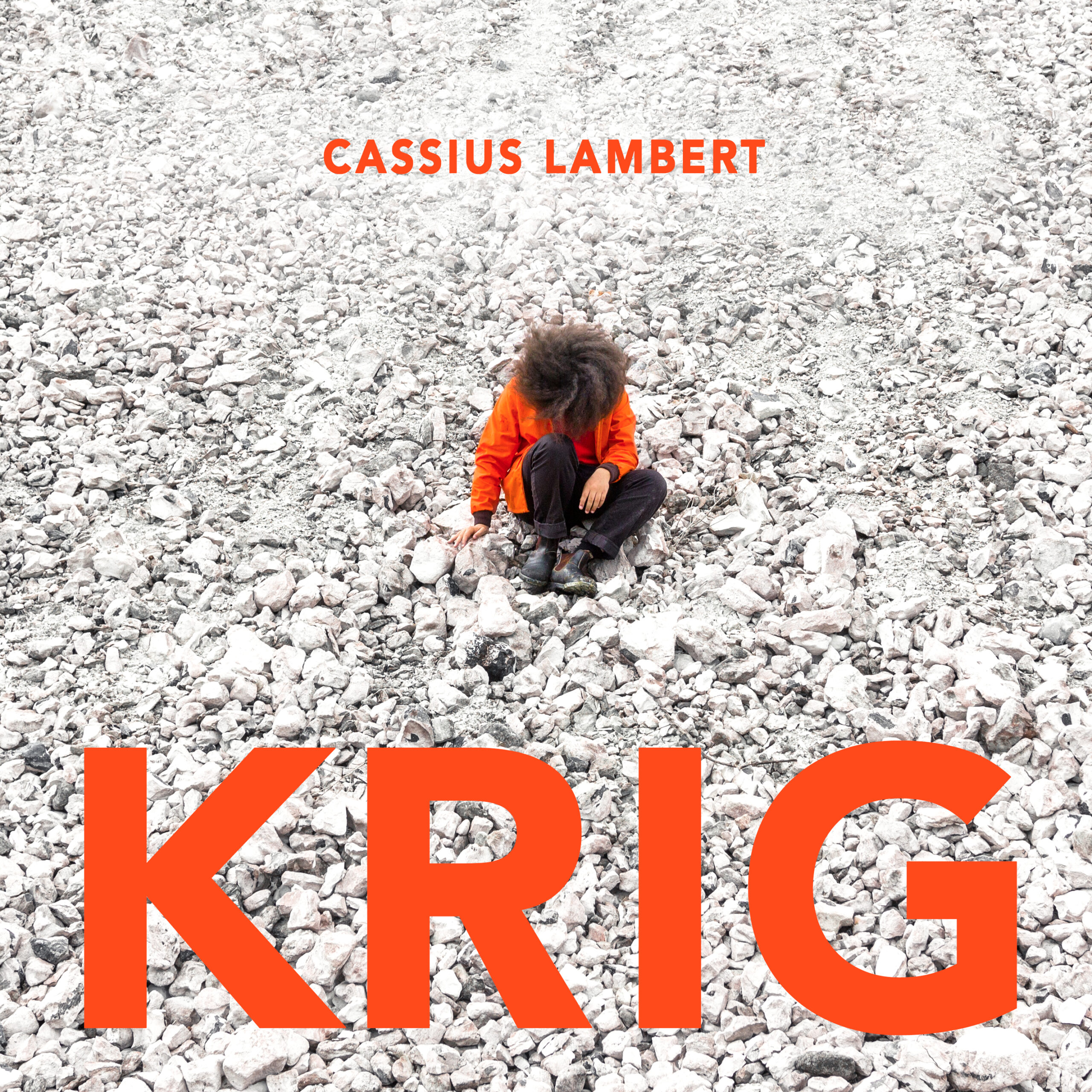 Cassius lamberts is sitting on white rocks. The name of the single is Krig.