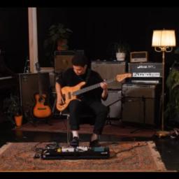 cassius lambert in studio, playing solo bass concert.